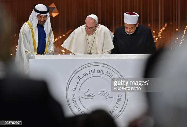 Abu Dhabi's Crown Prince Mohammed bin Zayed alNahyan watches as Pope Francis and Egypt's Azhar Grand Imam Sheikh Ahmed alTayeb sign documents during...