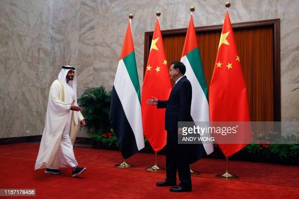 Abu Dhabi's Crown Prince Mohammed bin Zayed is greeted by Chinese Premier Li Keqiang before their meeting at the Great Hall of the People in Beijing...