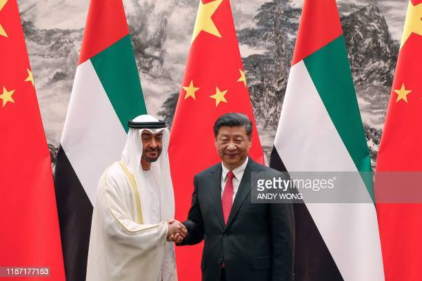 Abu Dhabi's Crown Prince Mohammed bin Zayed shakes hands with Chinese President Xi Jinping after witnessed a signing ceremony at the Great Hall of...