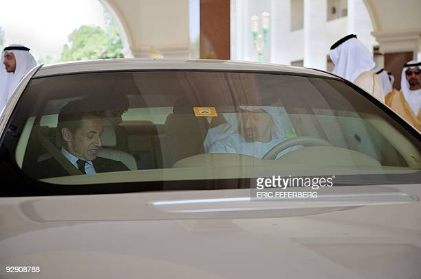 Abu Dhabi's Crown Prince Sheik Mohamed bin Zayed alNahayan drives French President Nicolas Sarkozy from AlMushrif palace to the inauguration of the...