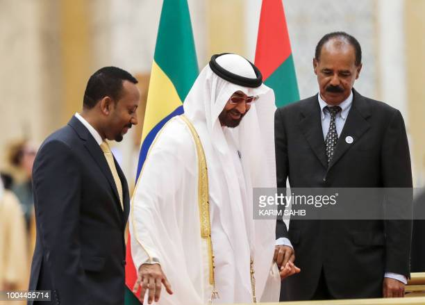 Abu Dhabi's Crown Prince Sheikh Mohamed bin Zayed Al Nahyan receives Ethiopian Prime Minister Abiy Ahmed and Eritrean President Isaias Afwerki at the...
