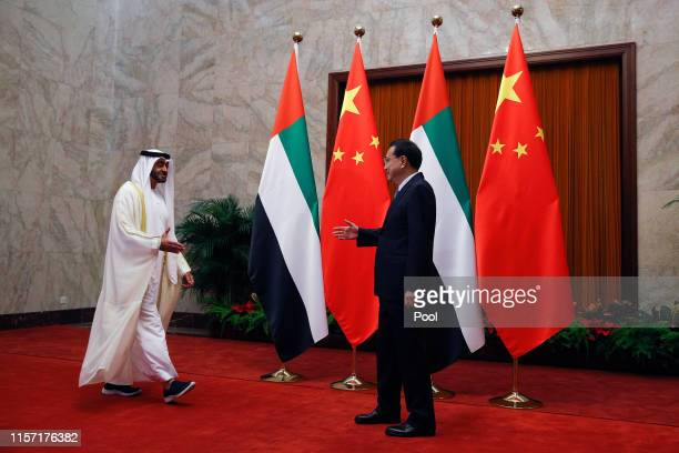 Abu Dhabi's crown prince, Sheikh Mohammed bin Zayed Al Nahyan, left, prepares to shakes hands with Chinese Premier Li Keqiang before a meeting at the...