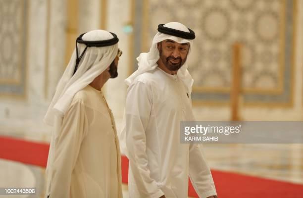 Abu Dhabi's Crown Prince Sheikh Mohammed bin Zayed Al Nahyan walks with Dubai Ruler and Minister of Defence Sheikh Mohammed bin Rashid Al Maktoum at...