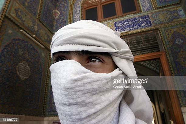 Abu Haqid a British volunteer stands outside the Imam Ali shrine on August 10 2004 in the holy city of Najaf Iraq He and others came from Britain on...
