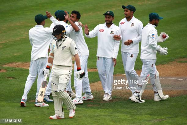 Abu Jayed of Bangladesh celebrates with teammates after taking the wicket of Tom Latham of New Zealand during day three of the second test match in...