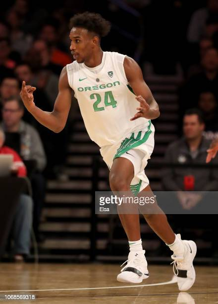 Abu Kigab of the Oregon Ducks celebrates his three point shot in the second half against the Syracuse Orange during the 2K Empire Classic at Madison...