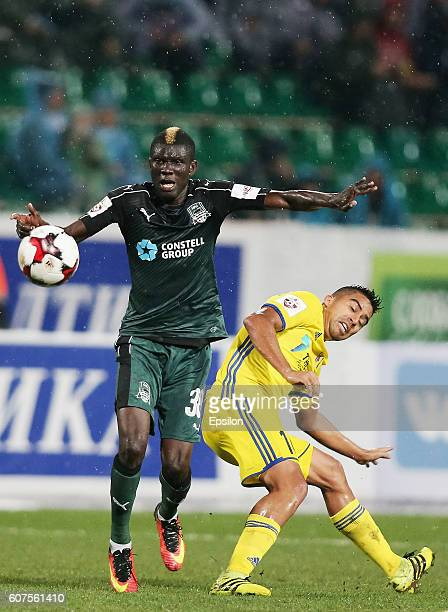Abu Kuassi of FC Krasnodar is challenged by Christian Noboa of FC Rostov during the Russian Premier League match between FC Krasnodar v FC Rostov at...