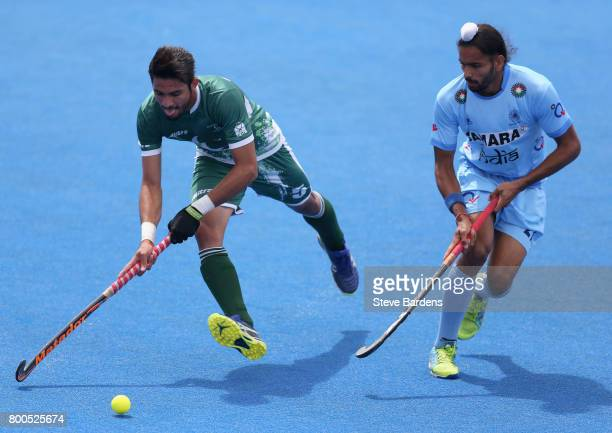 Abu Mahmood of Pakistan and Akashdeep Singh of India battle for possession during the 5th8th place match between Pakistan and India on day eight of...