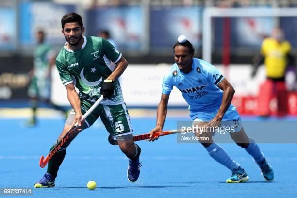 Abu Mahmood of Pakistan runs past Akashdeep Singh of India during the Hero Hockey World League Semi Final match between Pakistan and India at Lee...
