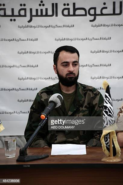 Abu Muhammad alFatih leader of Ajnad alSham attends a press conference with other brigade leaders in the rebelheld Eastern Ghouta region outside the...