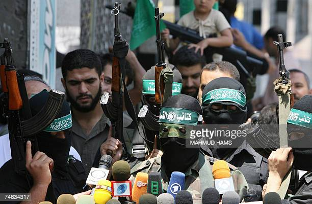 Abu Obeida a spokesman for Hamas's armed wing speaks to the press surrounded by armed men in Gaza City 15 June 2007 Hamas seized full control of the...