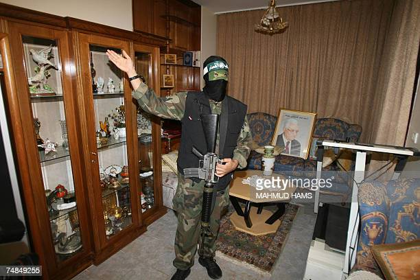 Abu Obeida a spokesman for Hamas's armed wing stands inside Palestinian leader Mahmud Abbas' house in Gaza City 21 June 2007 Hamas's armed wing...