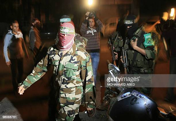 Abu Obeida a spokesman for Hamas's armed wing the Ezzedine AlQassam Brigade arrives to hold a press conference in Gaza City on March 26 2010 Two...