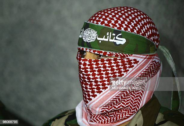 Abu Obeida a spokesman for Hamas's armed wing the Ezzedine AlQassam Brigade holds a press conference in Gaza City on March 26 2010 Two Israeli...