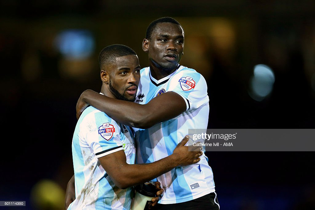 Abu Ogogo and Jermaine Grandison of Shrewsbury Town hug after the Sky Bet League One match between Peterborough United and Shrewsbury Town at London Road Stadium on December 12, 2015 in Peterborough, England.