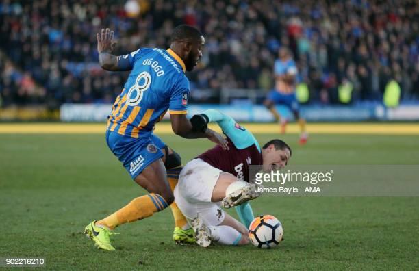 Abu Ogogo of Shrewsbury Town and Javier Hernandez of West Ham United during The Emirates FA Cup Third Round between Shrewsbury Town and West Ham...