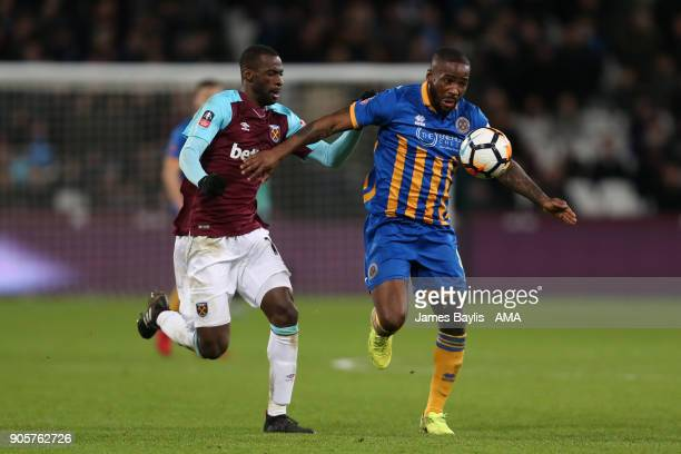 Abu Ogogo of Shrewsbury Town competes with Pedro Obiang of West Ham United during the Emirates FA Cup Third Round Repaly match between West Ham...