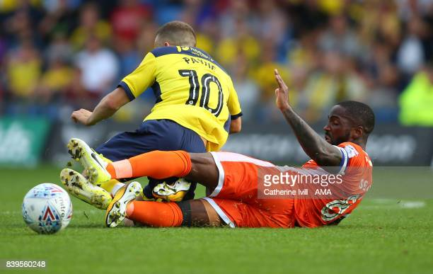 Abu Ogogo of Shrewsbury Town tackles Jack Payne of Oxford United during the Sky Bet League One match between Oxford United and Shrewsbury Town at...
