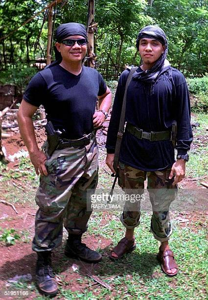 Abu Sabaya and Khadafy Janjalani leaders of a faction of the Abu Sayyaf Muslim extremist rebels pose for photograph in Jolo island 17 July 2000...