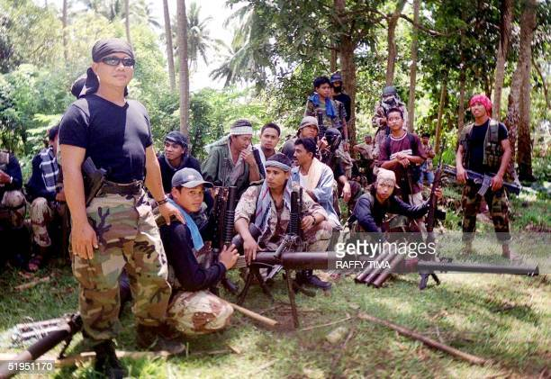 Abu Sabaya one of the leader of the Abu Sayyaf Muslim extremist guerrillas is seen with rebels displaying heavy weaponry while in Jolo island 17 July...