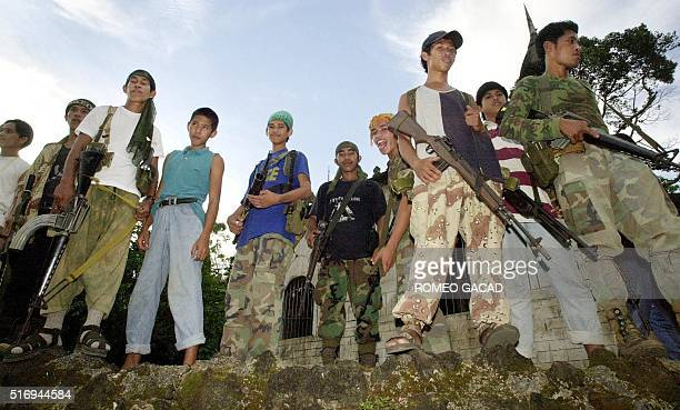 Abu Sayyaf Muslim gunmen display their weapons at their hideout in Jolo island shown in this file photo taken 27 May 2000 The Philippine government...