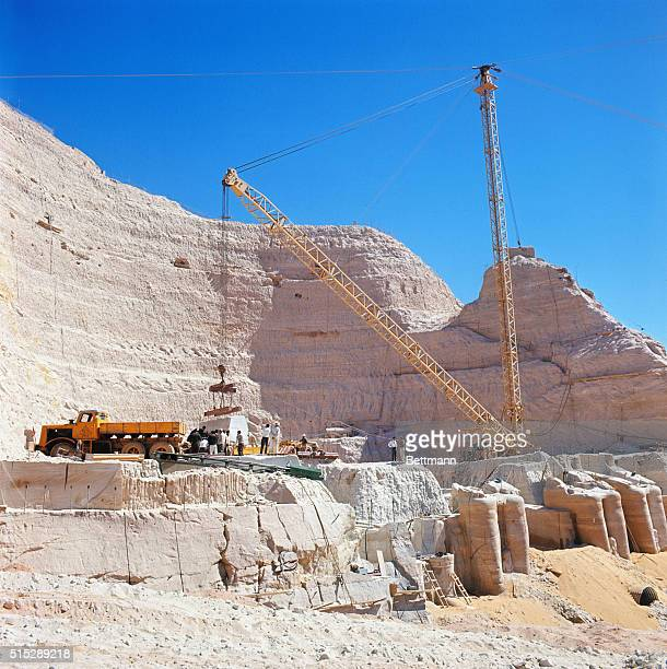 Abu Simbel UAR The site of Old Abu Simbel temple and the cavity in the rock after the temples were chopped up and moved to higher ground Workmen are...