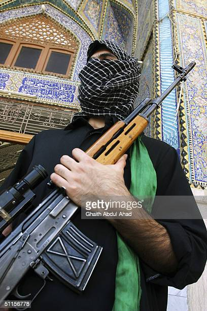 Abu Turab a British volunteer stands outside the Imam Ali shrine on August 10 2004 in the holy city of Najaf Iraq He and others came from Britain on...