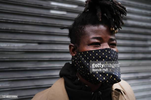Abubacar originally from Mali pauses with his homemade face masks in the Harlem neighborhood as fears increasingly grow over the coronavirus pandemic...