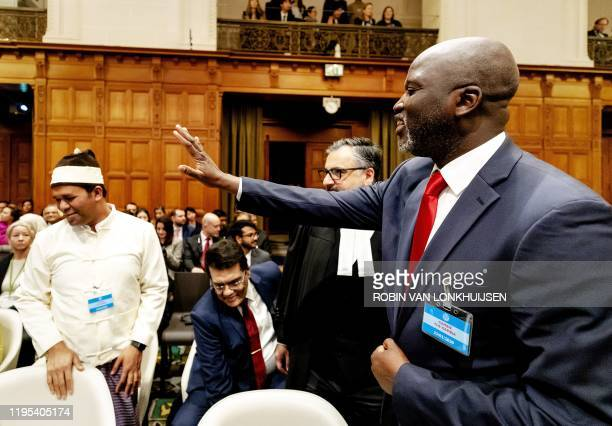 Abubacarr Tambadou, Minister of Justice of The Gambia waves to a representative of the Rohingya community prior to the ruling of the International...
