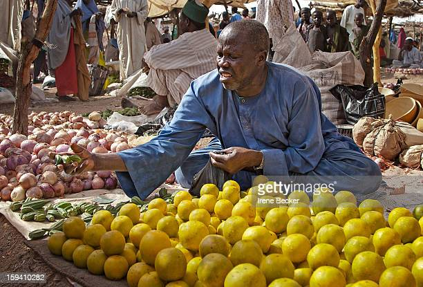 Abubakar Market A Kanuri trader selling fruits at local open market