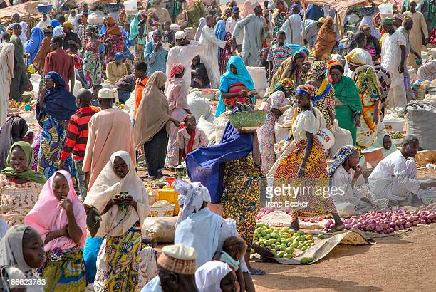 Abubakar Market, Borno State, Nigeria. Local market scene. The market is a meeting place for different ethnic groups and farmers to sell their...