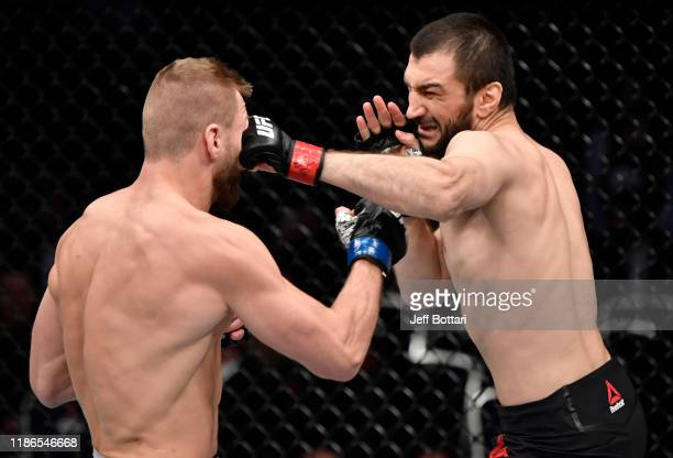 Abubakar Nurmagomedov of Russia punches David Zawada of Germany in their welterweight bout during the UFC Fight Night event at CSKA Arena on November...
