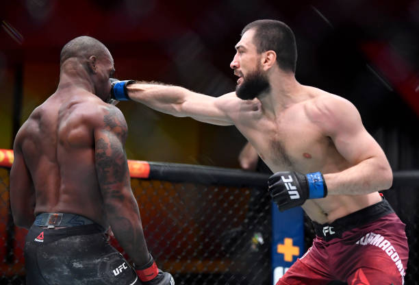 Abubakar Nurmagomedov of Russia punches Jared Gooden in their welterweight fight during the UFC 260 event at UFC APEX on March 27, 2021 in Las Vegas,...