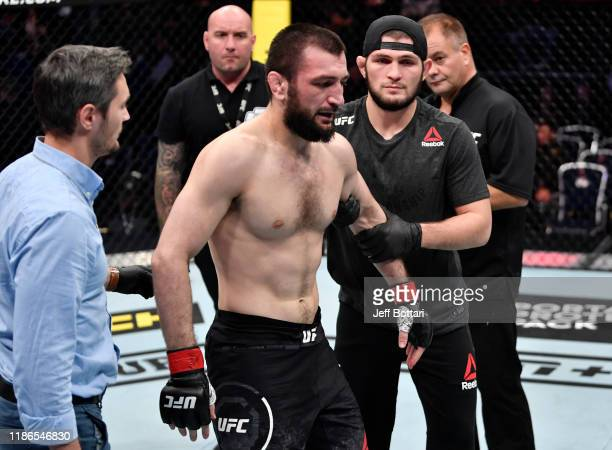 Abubakar Nurmagomedov of Russia reacts after his submission loss to David Zawada of Germany in their welterweight bout during the UFC Fight Night...