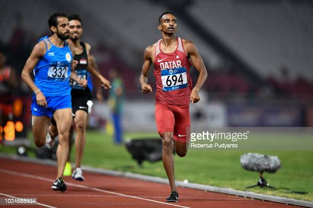 Abubaker Abdalla of Qatar and Manjit Singh of India compete during the Men's 800m Round 1 Heat 3 on day nine of the Asian Games on August 27 2018 in...