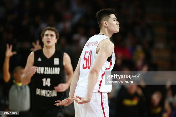 Abudushalamu Abudurexiti of China celebrates after hitting a three pointer during the FIBA World Cup Qualifying match between the New Zealand Tall...