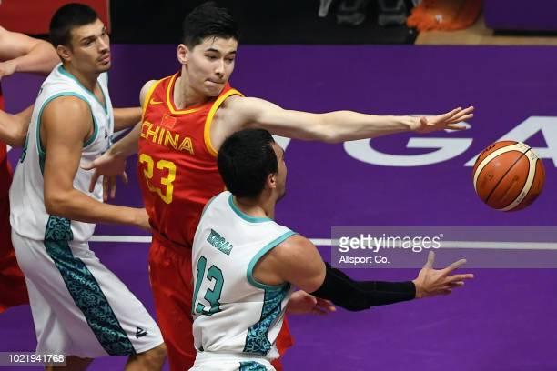 Abudushalamu Abudurexiti of China challenges Rustam Yergali of Kazakhstan during the Men's Basketball 5 x 5 Group D preliminary round match between...