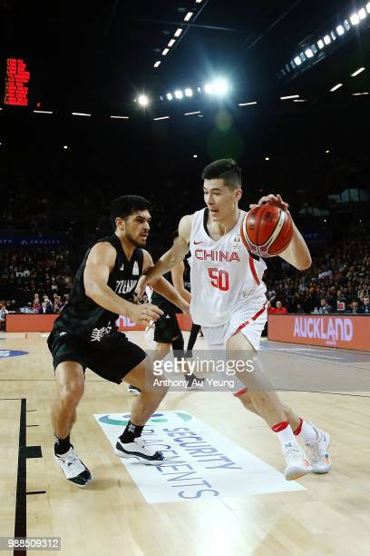 Abudushalamu Abudurexiti of China drives against Shea Ili of New Zealand during the FIBA World Cup Qualifying match between the New Zealand Tall...