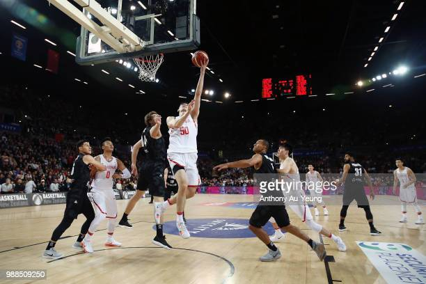 Abudushalamu Abudurexiti of China goes to the basket during the FIBA World Cup Qualifying match between the New Zealand Tall Blacks and China at...
