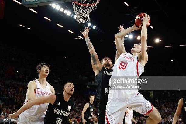 Abudushalamu Abudurexiti of China goes up against Isaac Fotu of New Zealand during the FIBA World Cup Qualifying match between the New Zealand Tall...