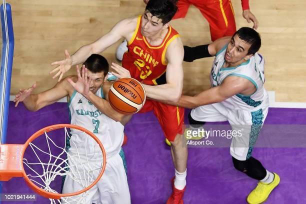Abudushalamu Abudurexiti of China shoots while Nikolay Bazhin of Kazakhstan challenges during the Men's Basketball 5 x 5 Group D preliminary round...