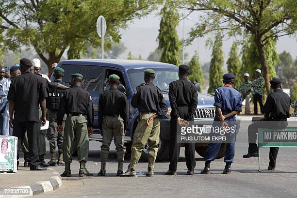 Antiriots policemen barricade one of the roads leading to the Eagle Square venue of the PDP presidential primary in Abuja 16 December 2006 More than...