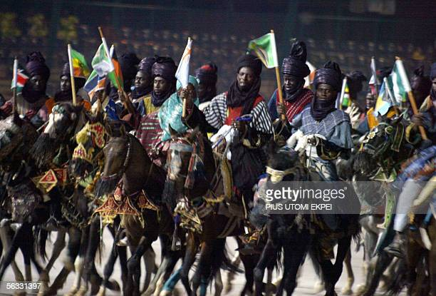 Horse riders raise African flags during a mini durbar in Abuja marking the opening of the 14th International conference on HIV/AIDS and Sexually...