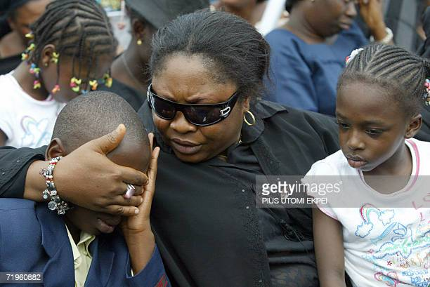 Magaret Abu a family friend conforts Master Seyi Adekunle son of the second pilot of the airforce Dornier plane that crashed killing thirteen senior...