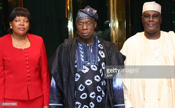 Nigeria President Olusegun Obasanjo and vicePresident Atiku Abubakar pose with Sao Tome and Principe's Prime Minister Maria Do Carmo 30 August 2005...