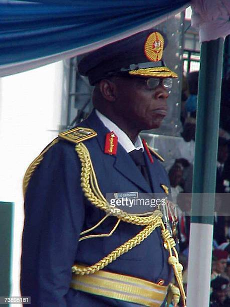 Nigerian President Olusegun Obasanjo dressed in an airforce ceremonial uniform takes salute during a farewell parade to mark airforce day in Abuja 16...