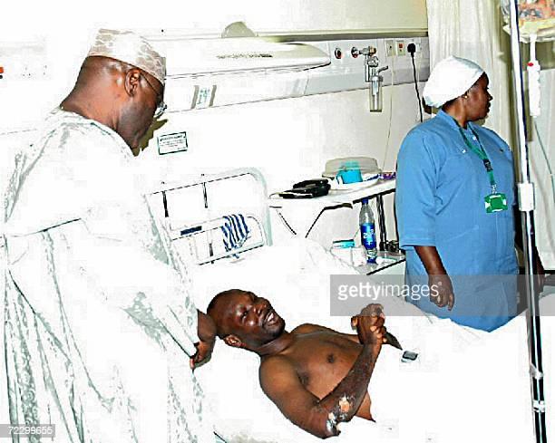 Nigerian vice president Atiku Abubakar visit a survivor of the crashed ADC flight 53 at a hospital in Abuja 30 October 2006 Nigeria revoked today the...