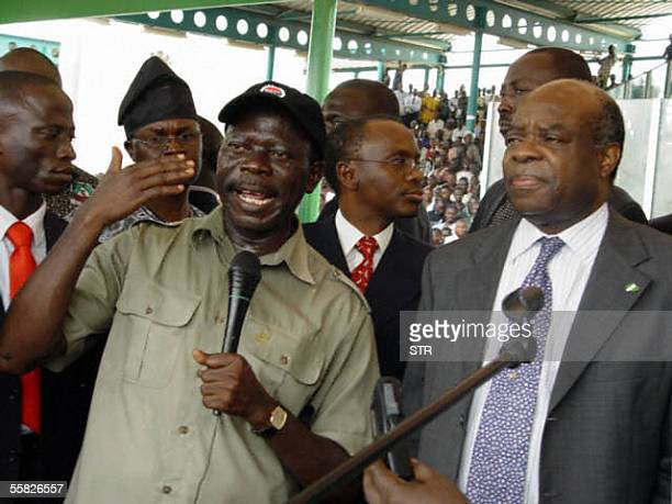 President of the Nigerian Labour Congress Adams Oshiomhole being watched by Secretary to the government Ufot Ekaette addresses workers during a...