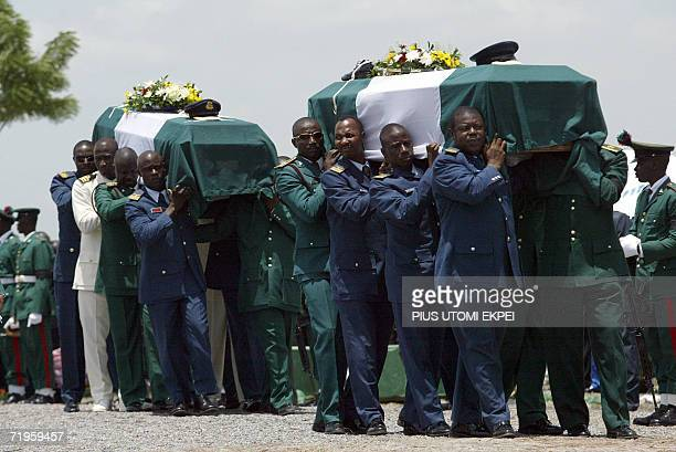 The bodies of ten Nigerian army generals and three others that died in an air crash are carried by pall bearers for burial at the military national...