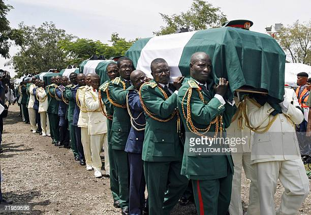 The bodies of ten Nigerian army generals and three others that died in an air crash being carried by pall bearers for burial 21 September 2006 at the...